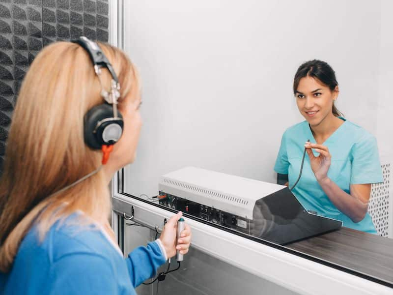 Picture of a woman taking a hearing test